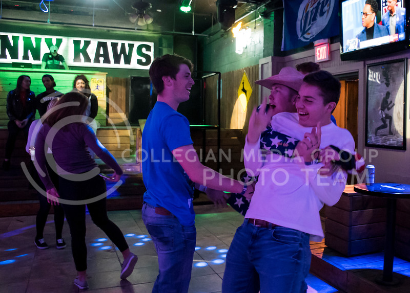A student excitedly greets his friend as he arrives to party at House Party located in Johny Kaws, in Manhattan, KS, on Nov. 3, 2017. (Olivia Bergmeier | Collegian Media Group)