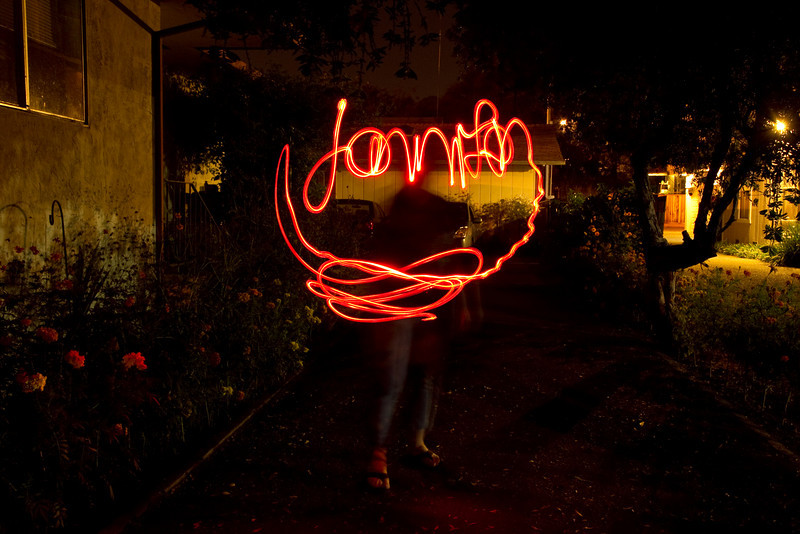 Jennifer light painting her name