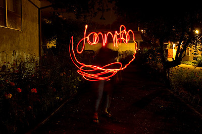 Jennifer light painting her name