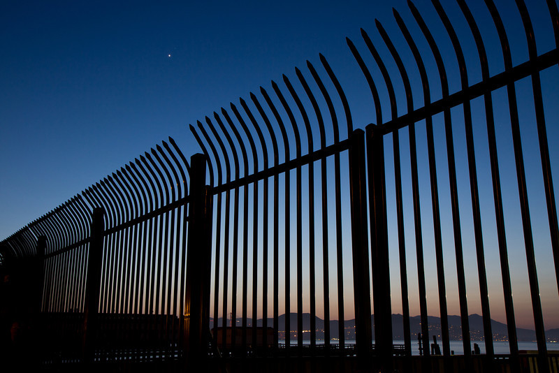 Fence to the municipal pier at Maritime Park, San Francisco. Taken at twilight with Jupiter in the west.