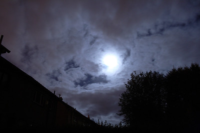 The moon in behind passing cloud.