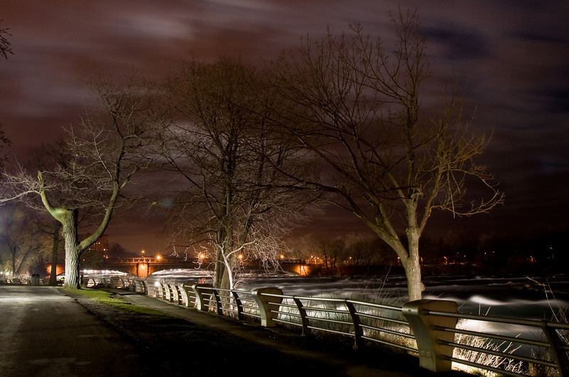 Niagara Falls State Park walkway at night with the Niagara River on the right.