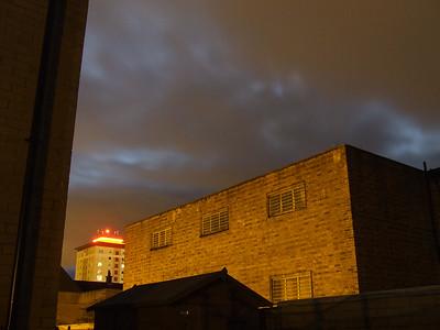 Evening sky. Moon behind the cloud.