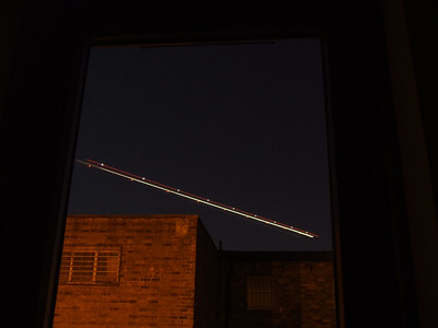 Aircraft light trails in the night time sky