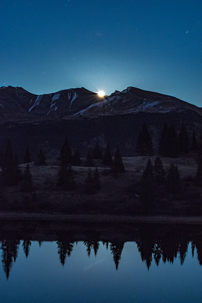 Supermoon coming over the peaks