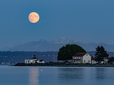 A wider view of last night's Hunter Moon rising over Point No Point lighthouse.