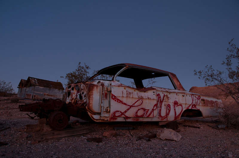 A Chevy Impala in Rhyolite, NV at twilight.