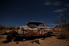 A Chevy Impala bathed in moonlight at Rhyolite, NV.