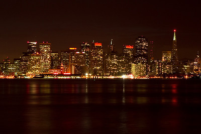 San Francisco lights and reflections from Treasure Island. The orange lights were in support of the San Francisco Giants playing in the World Series.