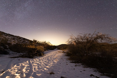 Snow in the Tortolita Mountains, with the glow of Tucson