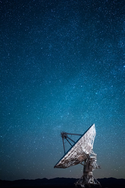 Stars over a radio telescope at the Karl G. Jansky Very Large Array National Radio Astronomy Observatory in New Mexico