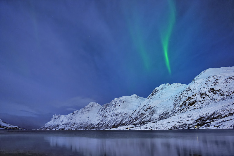 Aurora Borealis over Mountains near Tromso, Norway