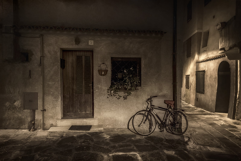 Bicycle on the streets of Grado, Italy at night
