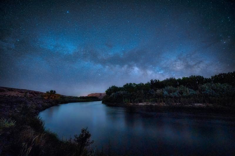 The Milky Way rises over the San Juan River at Sand Island near Bluff, Utah