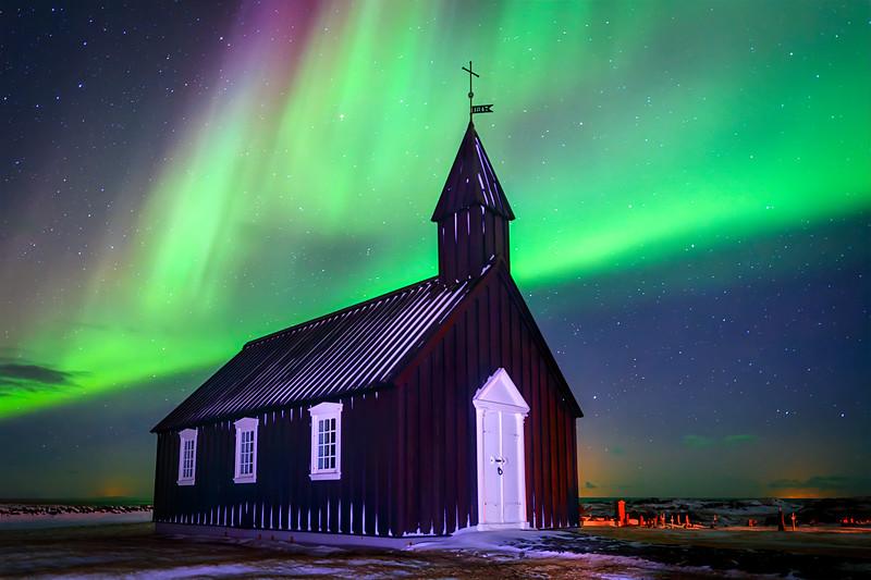 Northern Lights over Black church at Budir on the Snæfellsnes peninsula, Iceland
