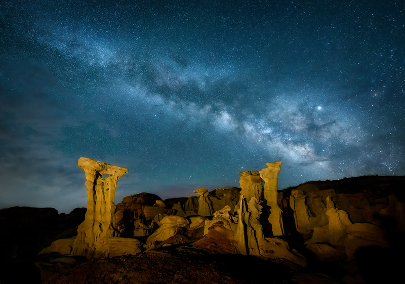 "The Milky Way over the ""Alien Throne"" and other hoodoo sandstone rock formations in the Valley of Dreams in the Ah-Shi-Sle-Pah Wilderness Study Area, New Mexico"