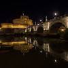 Castel Sant'Angelo and Ponte Sant'Angelo along the Tiber River at night, Rome, Italy