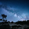 The Milky Way core rising over the tall sand dunes at Sturgeon Bay, Wilderness State Park, Northern Michigan