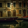 Reflection in canal at night in Dorsoduro, Venice, Italy