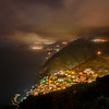View of the Mediterranean Sea and all five towns in Cinque Terre, Italy at night