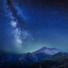 The Delta Aquariids meteor shower and Milky Way over Mount St. Helens, at Windy Ridge in Washington State with Mt. Hood, Oregon visible in the lower left corner.  Portland, Oregon is fifty miles to the south as you can tell by the ambient light behind Mount St. Helens.