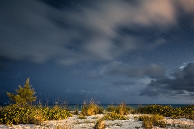 Clouds and stars over the sand dunes on the beach on Boca Grande, Florida