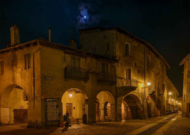 Moon over a street in the old town of Susa at night, Piedmont, Italy.  Susa was founded by the Gauls and in the late 1st Century BC became part of the Roman Empire.