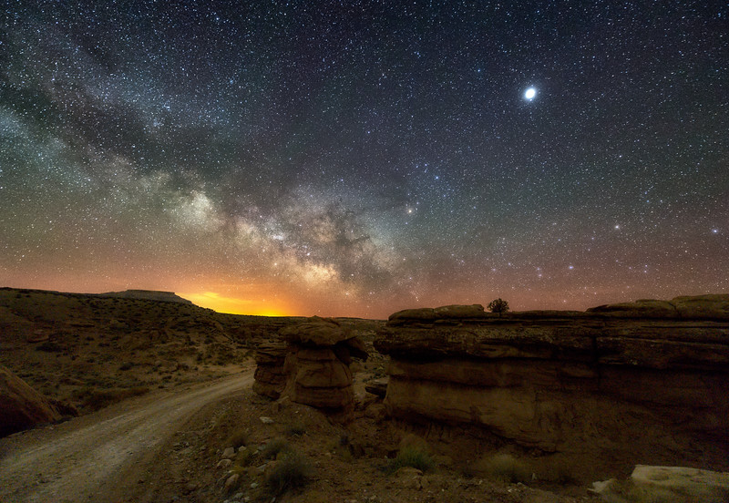 The Milky Way over Hoodoos and road to Recapture Pocket outside of Bluff, Utah