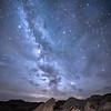 Perseids meteors and the Milky Way over toadstool rock formations in Toadstool Geological Park in northwestern Nebraska