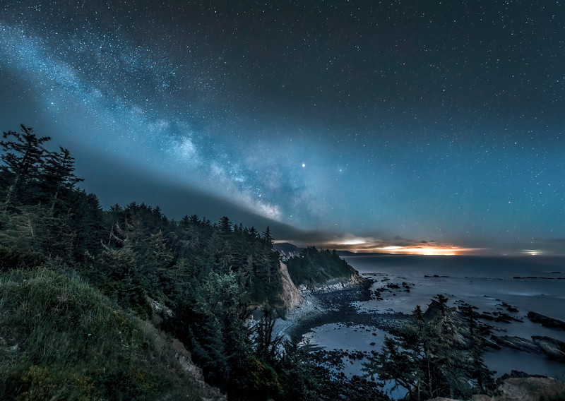 The Milky Way, meteors and the planet Jupiter over Cape Arago State Park, Oregon Coast