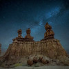 The tail end of the Milky Way over The Three Sisters hoodoo in Goblin Valley State Park, Utah