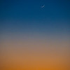 The planet Mars just above the waxing crescent moon just after sunset at Goosenecks State Park near Mexican Hat, Utah