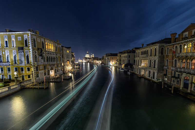 View of light streaks from boats on the Grand Canal near Accademia Bridge, Venice, Italy