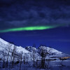 Aurora Borealis Over Moonlit Mountains near Tromso, Norway