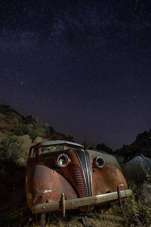 Milky Way over an abandoned car at Keys Ranch, Joshua Tree National Park