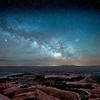 The Milky Way over Grand View Point Overlook at the very windy edge of the Island in the Sky mesa in Canyonlands National Park, Utah