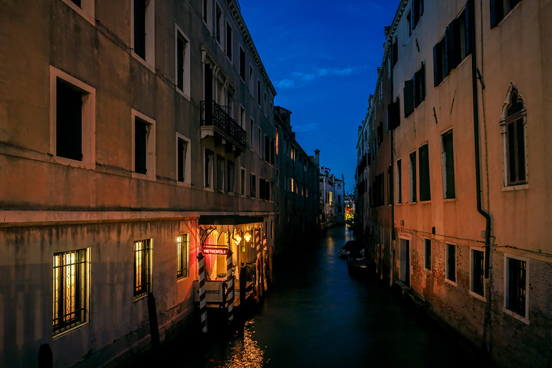 Night view of Metropole Restaurant along a canal near St. Mark's Square, Venice, Italy