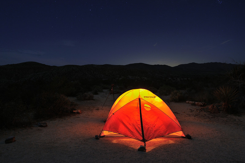 Marmot Tent with Lamp at night in Joshua Tree National Park, California