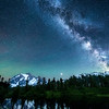 The Milky Way, meteors and Northern Lights above Mount Shuksan reflected in Highwood Lake, Mount Baker-Snoqualmie National Forest, Washington State