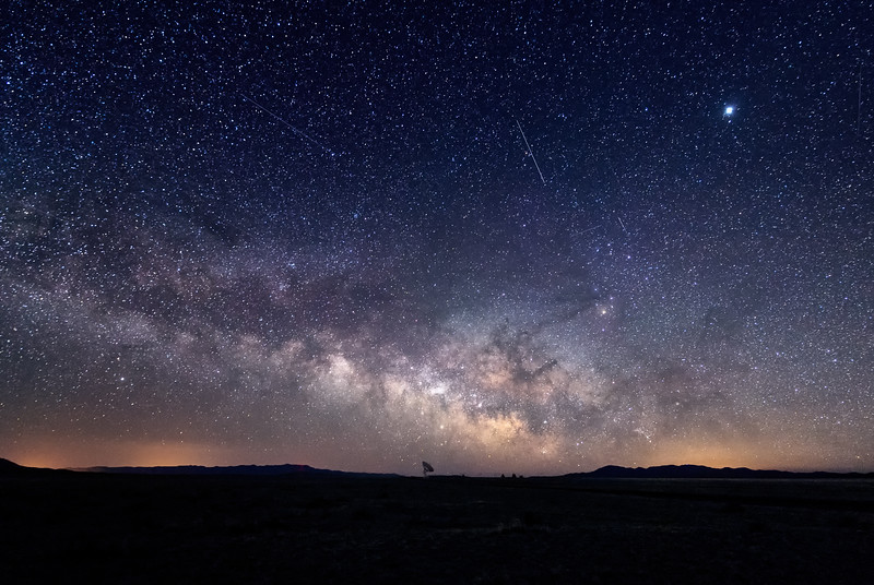The Milky Way and meteors over a radio telescope at the Karl G. Jansky Very Large Array National Radio Astronomy Observatory in New Mexico