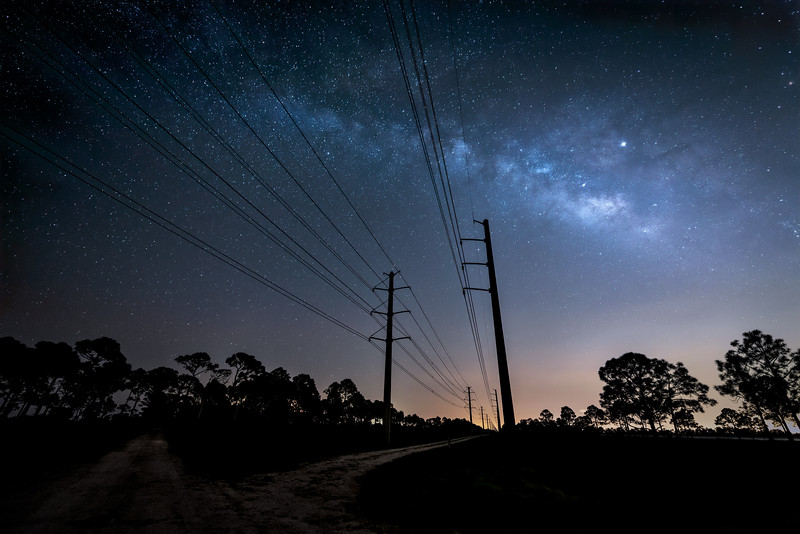 The Milky Way over power lines near Babcock Wildlife Management Area near Punta Gorda, Florida