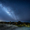 The Milky Way and Jupiter over the rocks at Turner Beach on Captiva Island, Florida