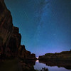 Meteor and Milky Way over the Colorado River on Potash Road near Moab, Utah