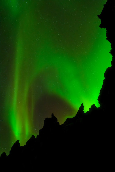 Northern Lights over lava rocks near the Snæfellsjökull Glacier in Western Iceland