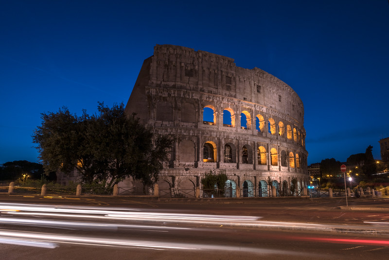 The Colosseum at night with traffic light streaks, Rome, Italy