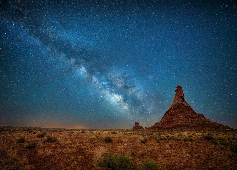 The Milky Way over two rock formations in the Valley of the Gods outside of Bluff, Utah