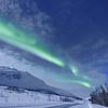 Aurora Borealis Over Norwegian Road at Night