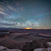 The Waning Gibbous moon rises just under the rising Milky Way core over Dead Horse Point with the silhouetted La Sal Mountains on the left, Moab, Utah