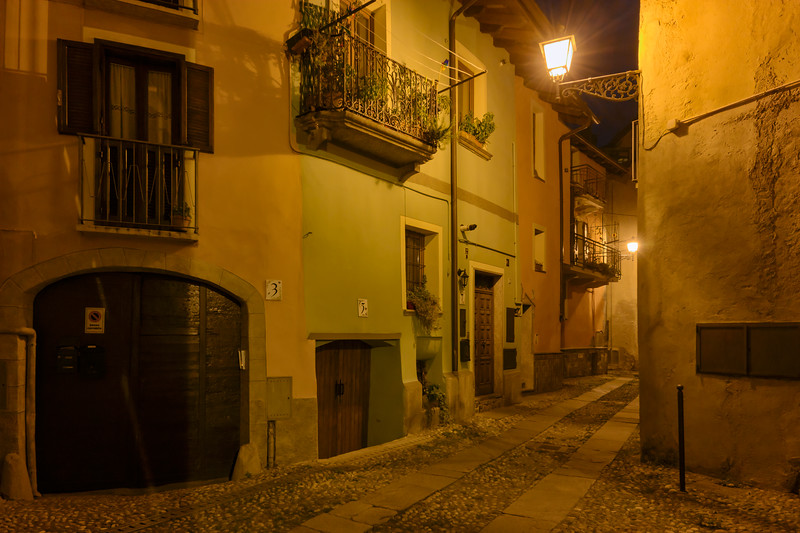 A street in the old town of Susa at night, Piedmont, Italy.  Susa was founded by the Gauls and in the late 1st Century BC became part of the Roman Empire.