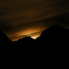 """Mountain Moon"". Moon rising over Zion National Park at midnight."